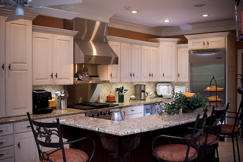 kitchen remodel with white cabinets, granite countertops, stainless hood and appliances | Marchand Creative Kitchens Cabinets New Orleans Metairie Mandeville LA