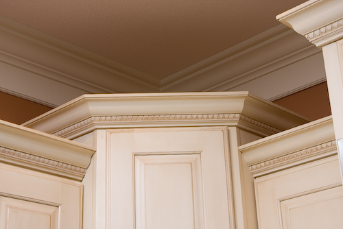 off white cabinet crown molding at top | Marchand Creative Kitchens Cabinets New Orleans Metairie Mandeville LA