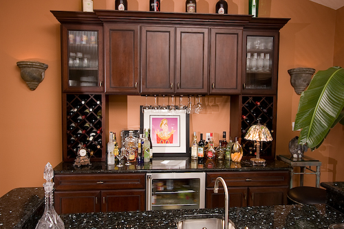dark wood cabinets and wet bar | Marchand Creative Kitchens Cabinets New Orleans Metairie Mandeville LA