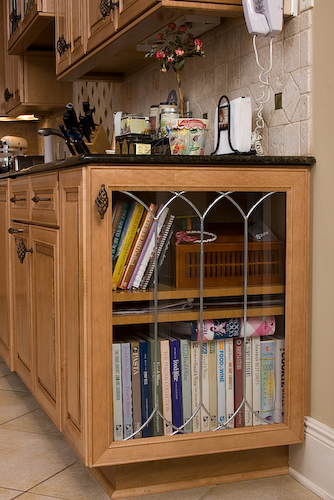 cookbook end cabinet with leaded glass door | Marchand Creative Kitchens Cabinets New Orleans Metairie Mandeville LA
