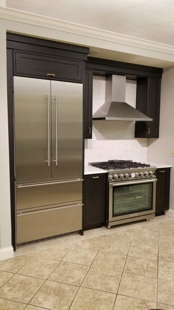 Liebherr Refrigerator, Zephyr Hood and Superiore Range with dark cabinets and white countertop | Marchand Creative Kitchens Cabinets New Orleans Metairie Mandeville LA