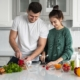 young-couple-cooking-home | Marchand Kitchens Metairie and Mandeville, LA